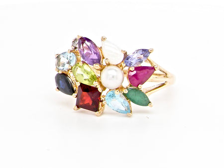 A multi gemstone cluster dress ring