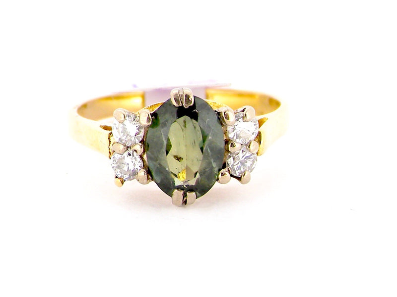 A green sapphire and diamond ring
