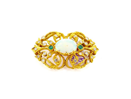 A vintage opal and diamond brooch
