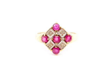 A 9 carat gold ruby and diamond cluster ring