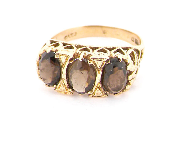 A three stone smoky quartz dress ring
