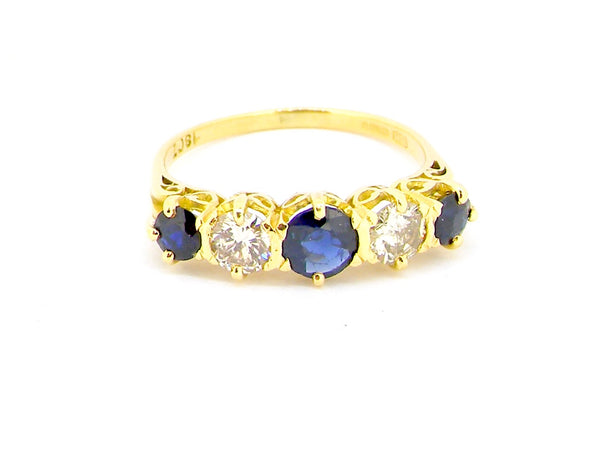 An 18 carat gold five stone sapphire and diamond ring
