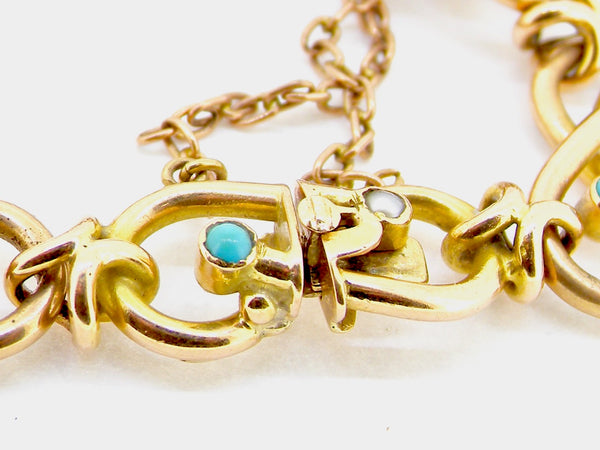 A vintage 15 carat gold turquoise and pearl bracelet
