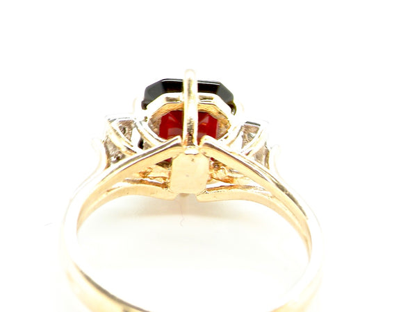 A 9 carat gold garnet and diamond dress ring