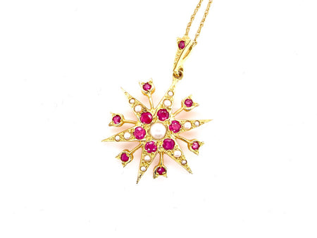 A vintage ruby and diamond star shaped pendant