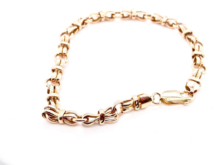 A 9 carat gold bow linked bracelet
