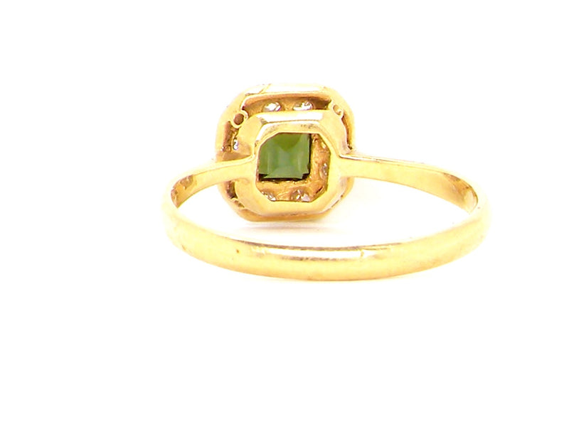 A vintage green tourmaline and diamond cluster ring