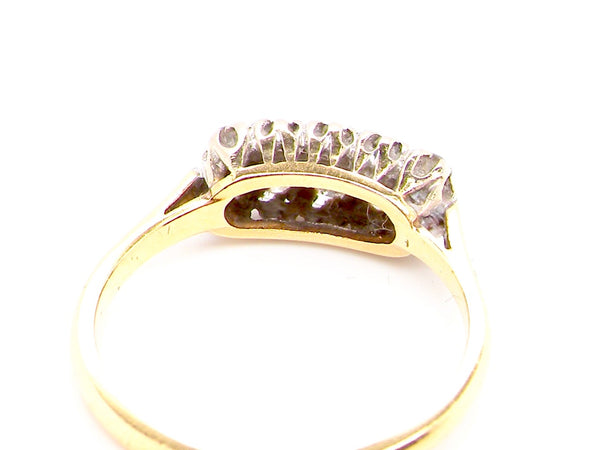 An Edwardian ten stone diamond ring