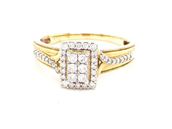A modern 9 carat gold rectangular diamond cluster ring