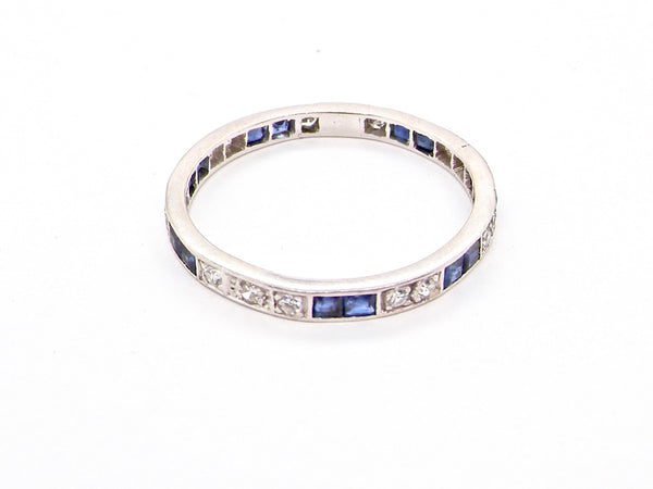 A narrow sapphire and diamond eternity ring