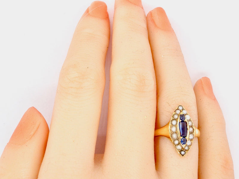 A marquise shaped sapphire and pearl ring