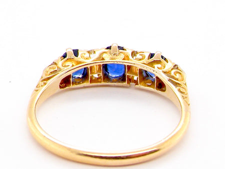 A vintage sapphire and diamond half hoop ring