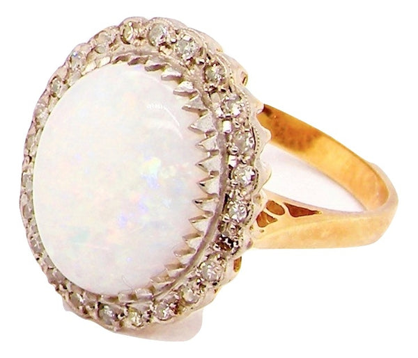 A large opal and diamond cluster gem ring