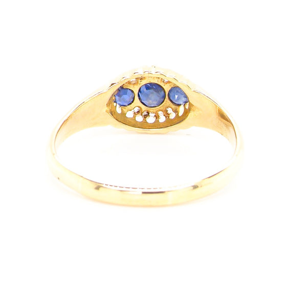An 18 carat gold Edwardian sapphire and diamond ring