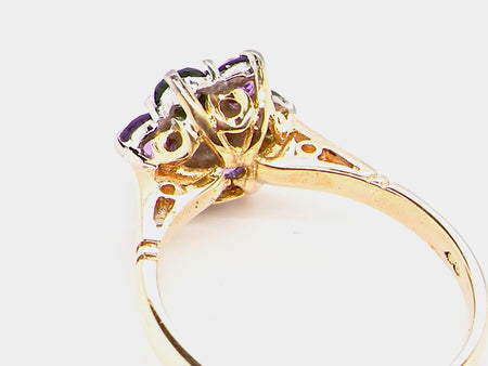 An 18 carat gold tourmaline and amethyst dress ring
