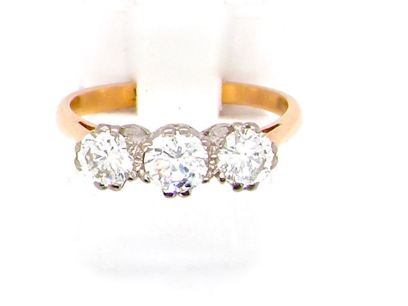 A three stone diamond trilogy ring