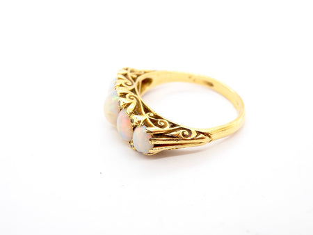 An 18 carat gold opal dress ring