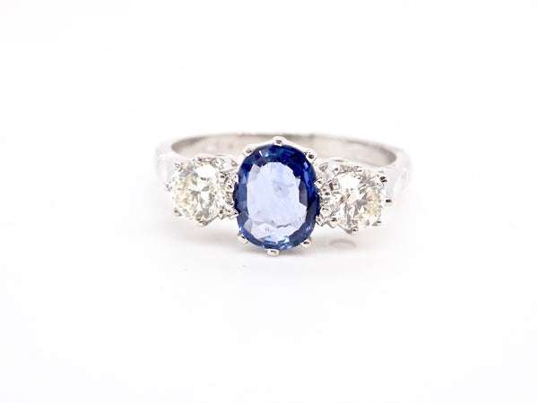 A fine sapphire and diamond three stone ring
