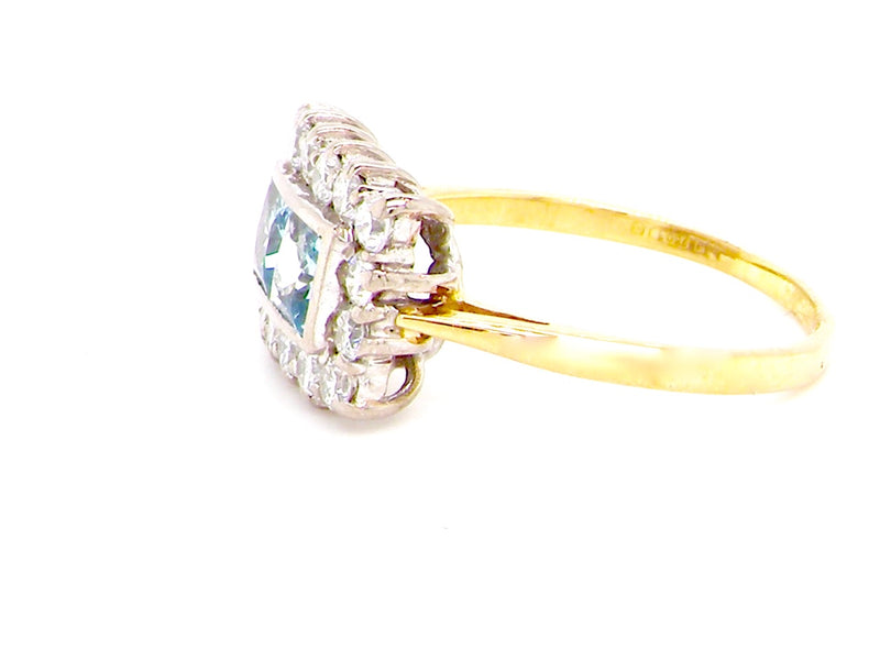 A rectangular aquamarine and diamond cluster ring