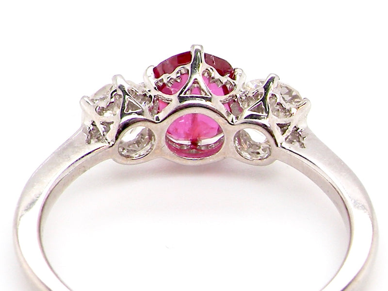 A fine three stone ruby and diamond ring