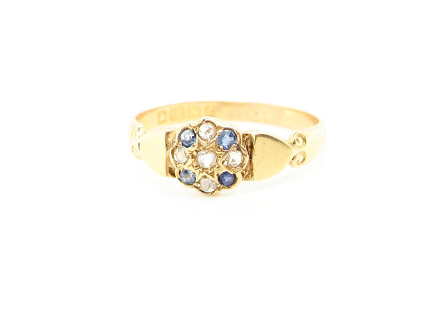 An 18 carat gold sapphire and diamond cluster ring