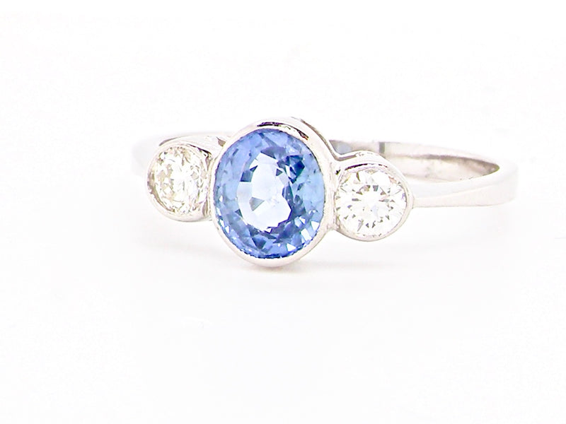 A sapphire and diamond trilogy stone ring