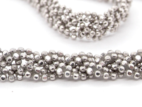 A white gold* threaded bead necklace
