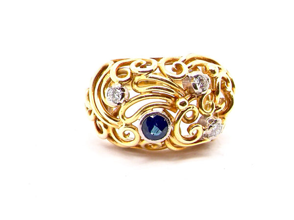 A vintage sapphire and diamond bombe design ring