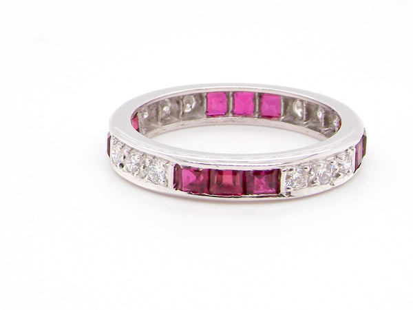 An 18 carat gold ruby and diamond eternity ring