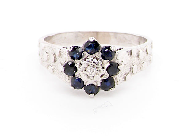 A 1970s  white gold sapphire and diamond cluster ring