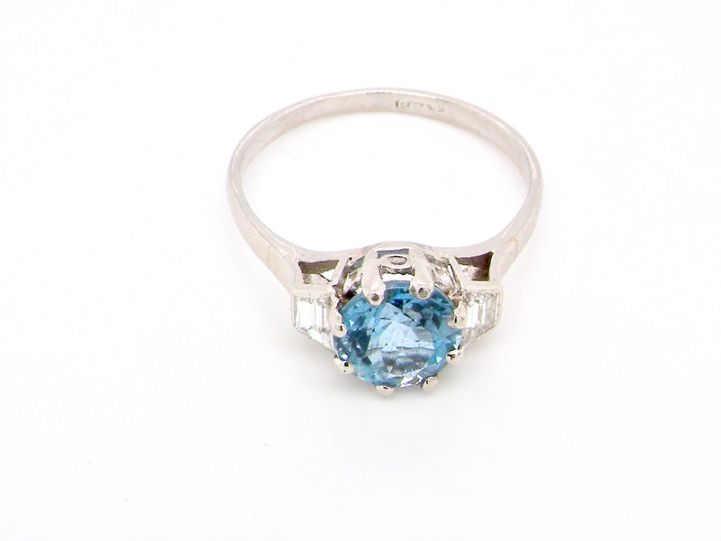 A platinum aquamarine and diamond ring-Special Offer for March