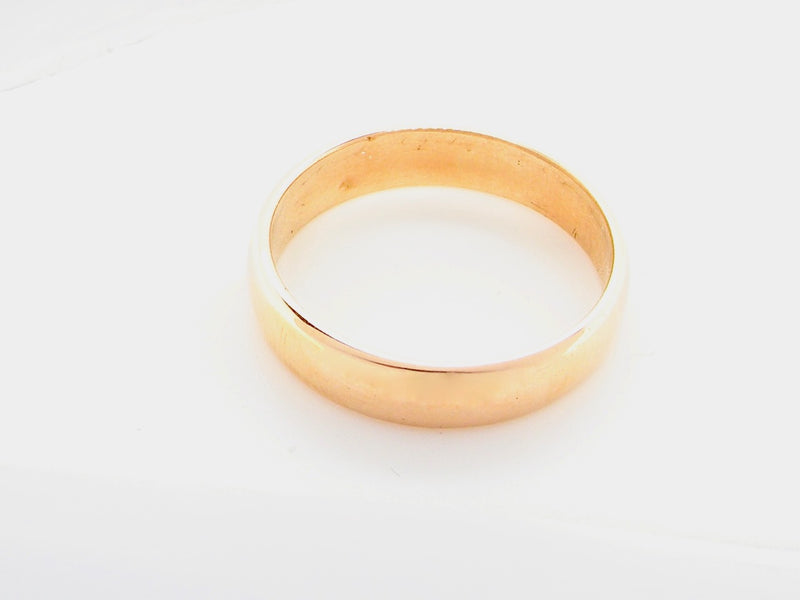 A high carat gold D shaped wedding ring