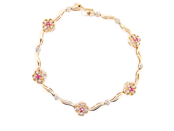 A ruby and diamond 9 carat gold bracelet