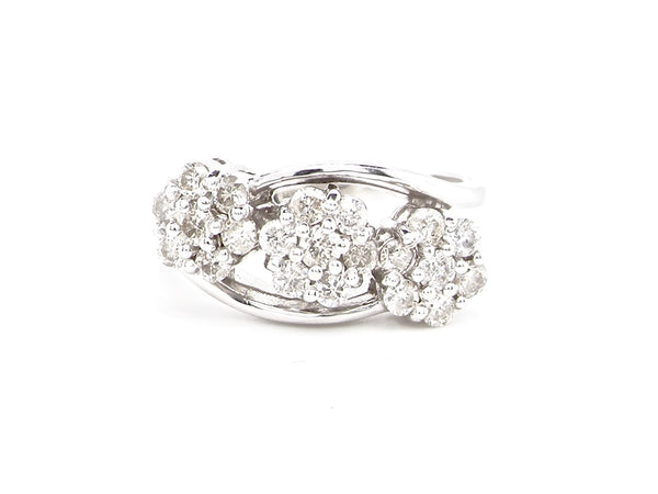 An 18 carat white gold triple diamond cluster ring