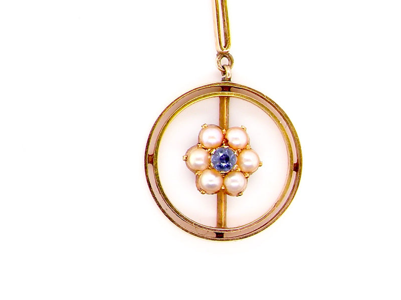 An Edwardian 15 carat gold sapphire and pearl pendant
