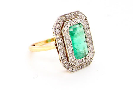 A fine Edwardian emerald and diamond cluster ring