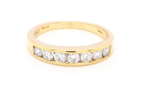 An 18 carat gold half hoop eternity ring