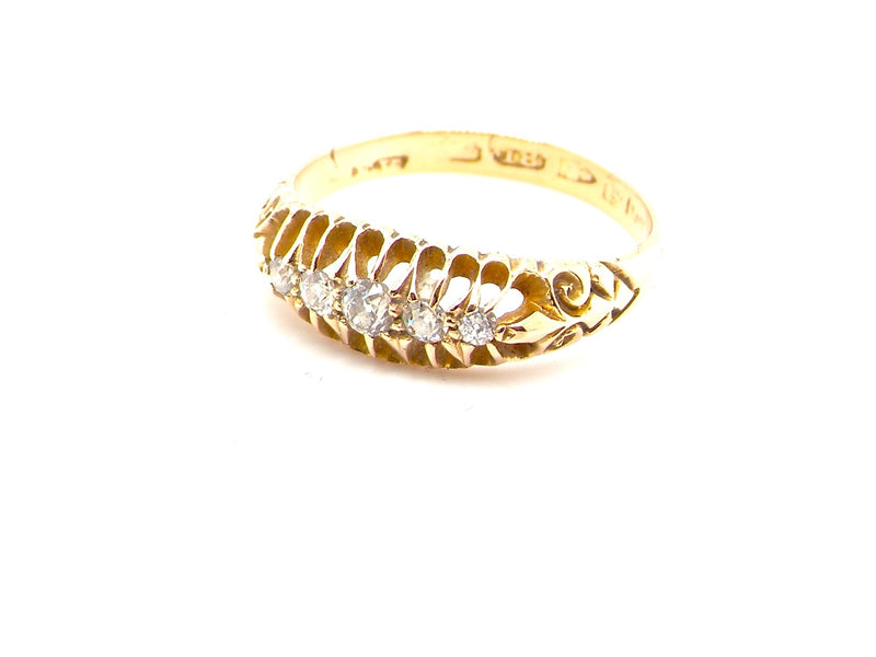An 18 carat gold antique five stone diamond ring
