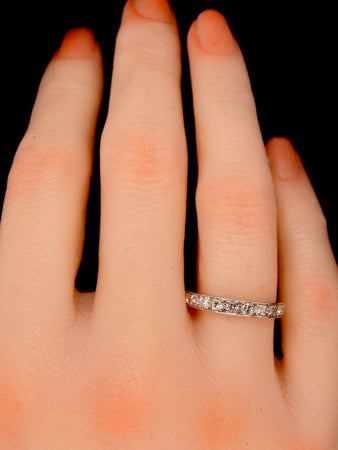 A platinum diamond set eternity ring