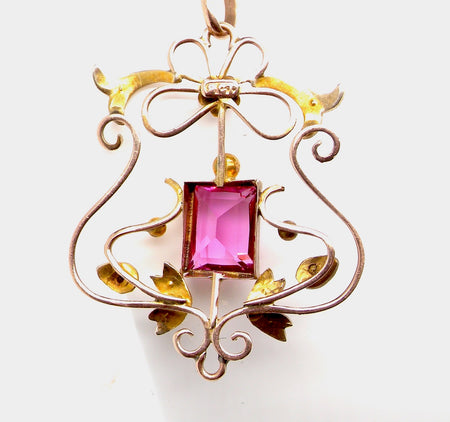 An Edwardian pink tourmaline and pearl pendant