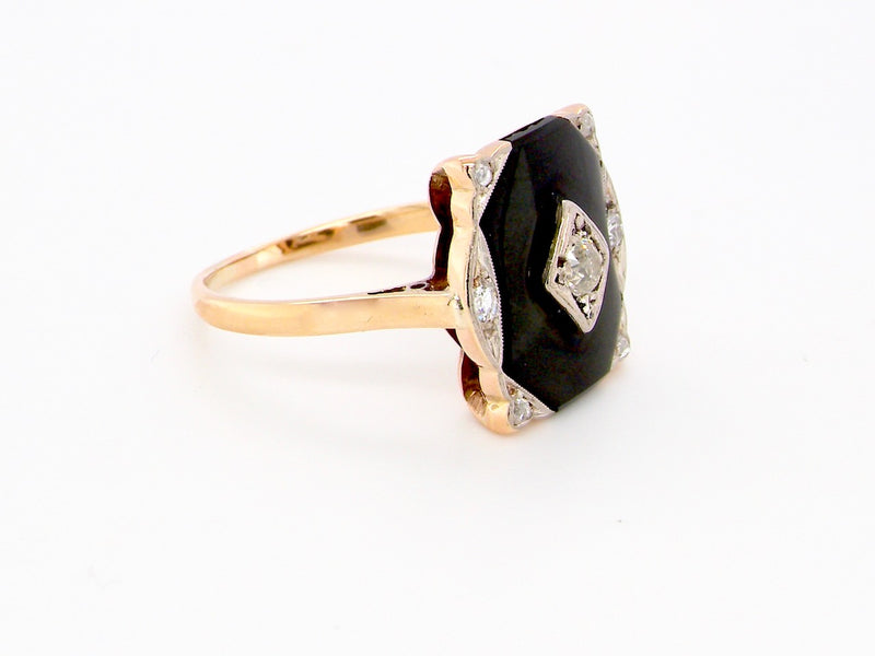An Edwardian diamond and onyx ring