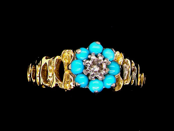 A pretty turquoise and diamond dress ring