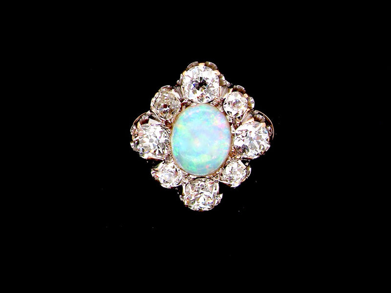 A fine Art Deco opal and diamond cluster ring