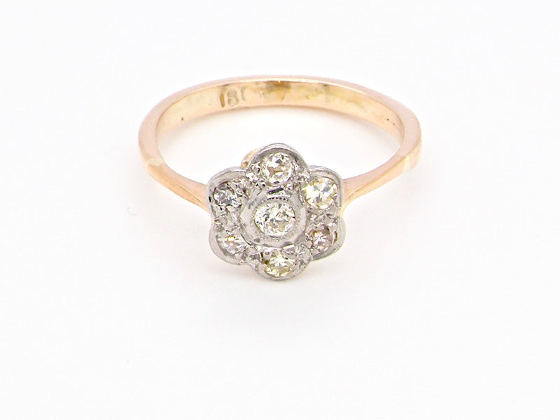 An Edwardian diamond daisy cluster ring