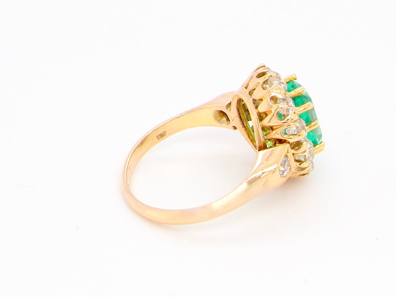A fabulous emerald and diamond cluster ring