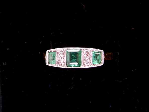 An Edwardian emerald and diamond ring