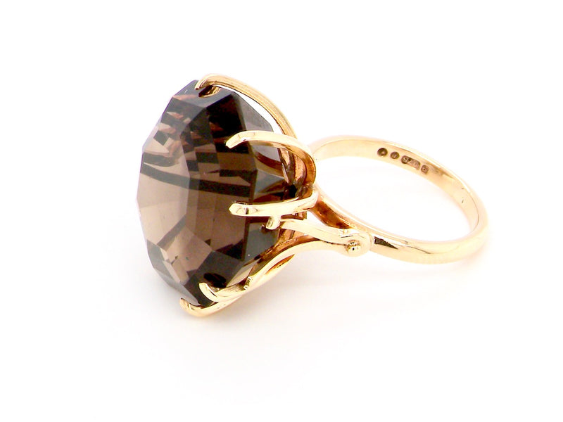 A large smoky quartz dress ring