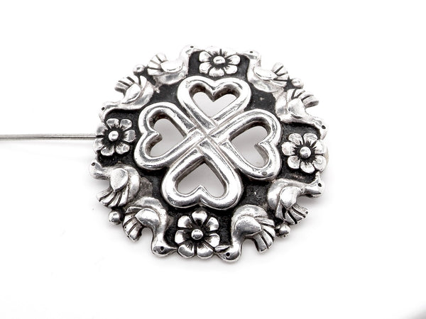 A silver brooch by Kelt