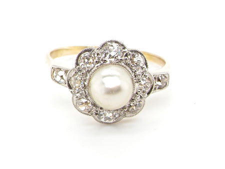 A fine pearl and diamond cluster ring