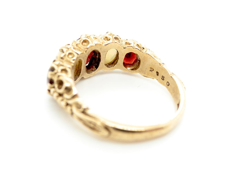 A 9 carat gold opal and garnet dress ring